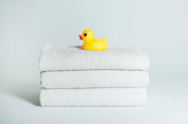 Ente auf Handtüchern