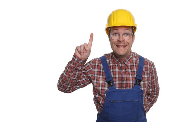 Bauarbeiter mit erhobenen Zeigefinger