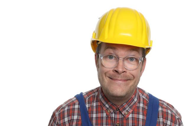 lächelnder Bauarbeiter