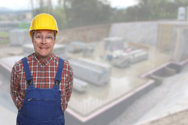 Bauarbeiter vor Baugrube