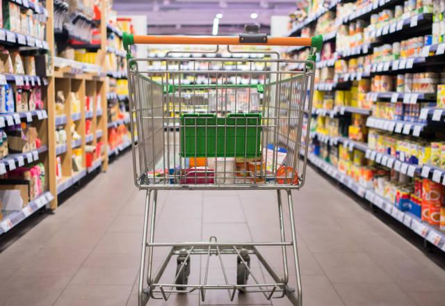 Shopping cart moving through isle of market