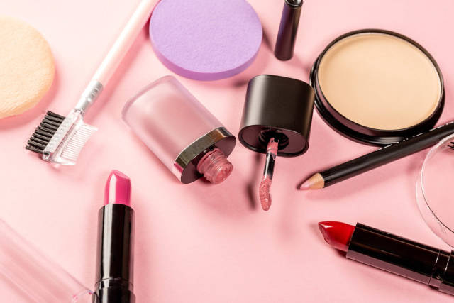 Womens cosmetics on pink background
