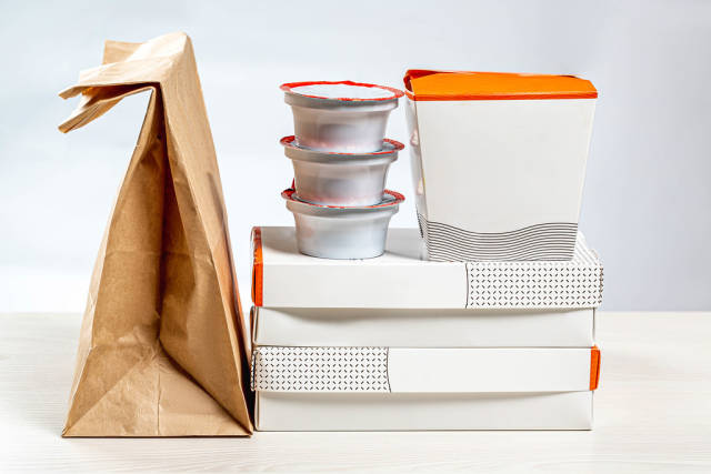 Set of Packed in paper containers and boxes of Chinese food. Home food delivery concept