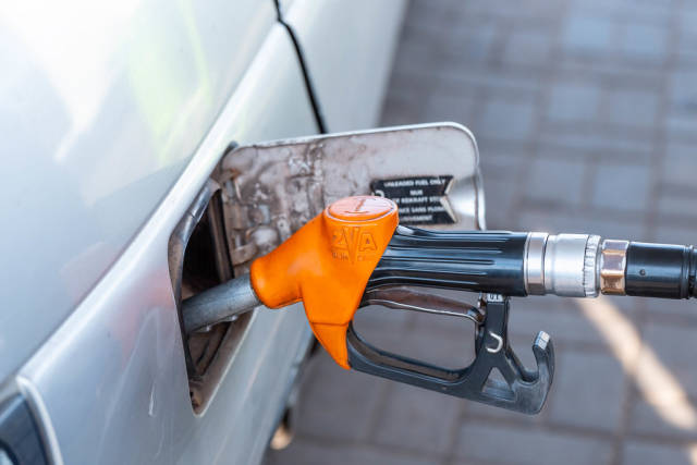 Filling the car with gasoline at the gas station