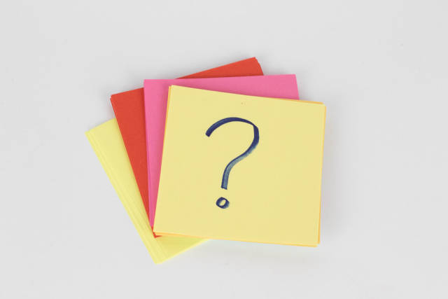 Question mark on sticky note