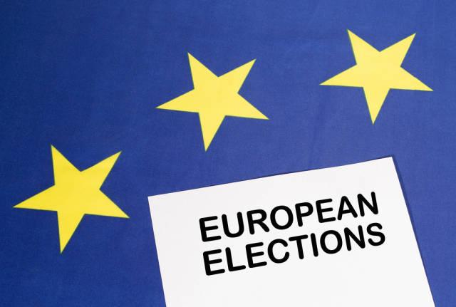 White paper with European elections text on European Union flag