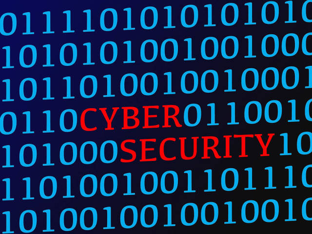 Cyber security red text between blue binary data on screen