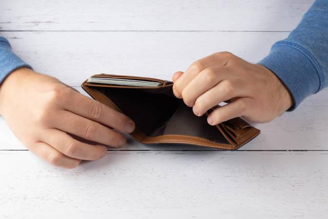 Man hand holding empty wallet