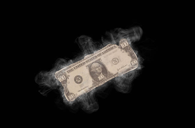Dollar banknote with smoke on black background