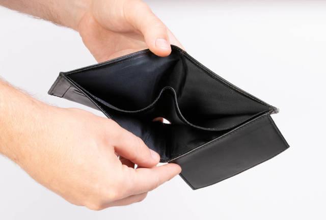 Hands showing empty wallet