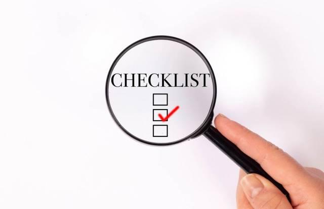 Checklist under magnifying glass