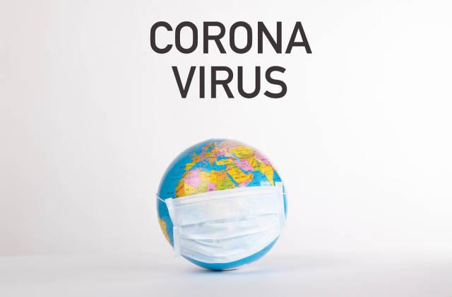 Globe with medical mask and Corona Virus text on white background