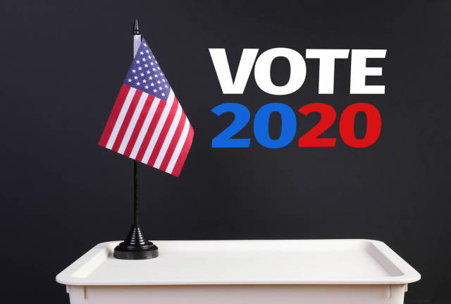 Ballot box with American flag and Vote 2020 text