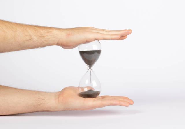 Man holding hourglass