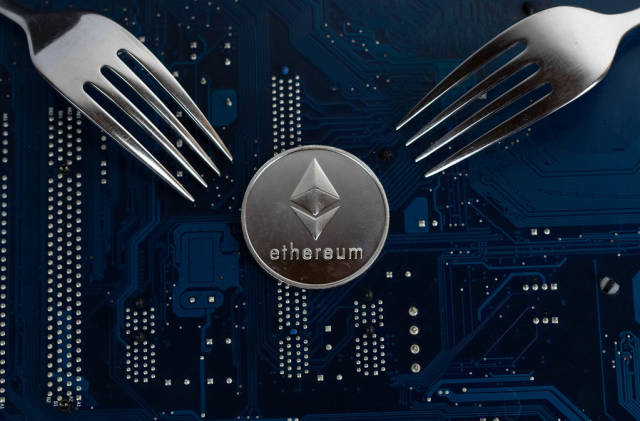 Ethereum coin with forks on motherboard