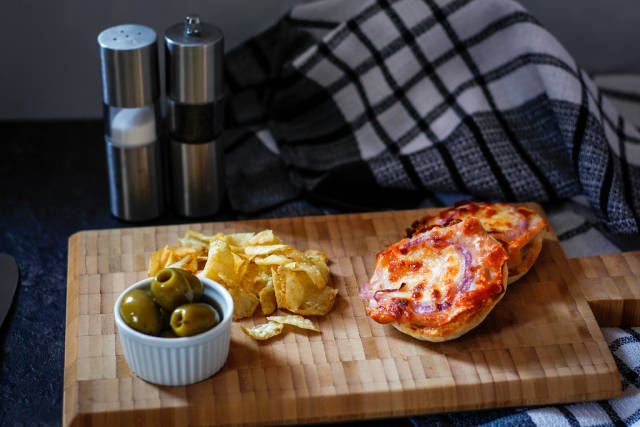 Small pizza on a cutting board