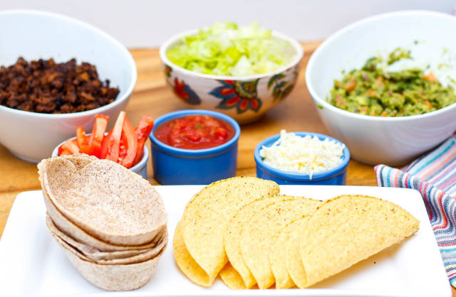 Tacos with Cheese, Salsa, Guacamole, Beef, and Salad