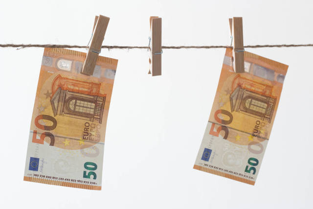 Fifty euros bills hanging on the rope