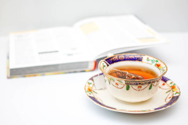 Cup of Tea with Book in the Background