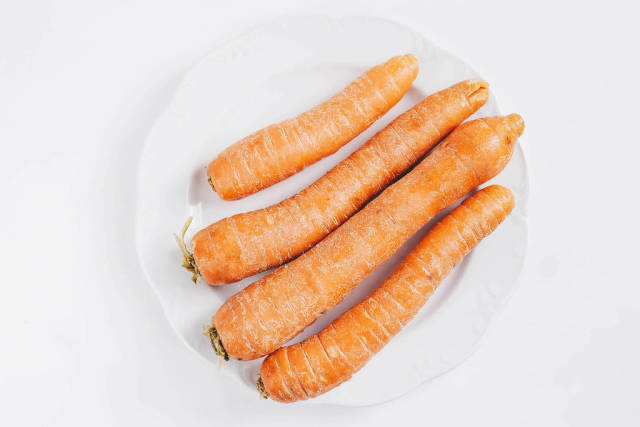 Top view of group of carrots on white background