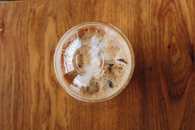Top view of take away cup with ice cappuccino.