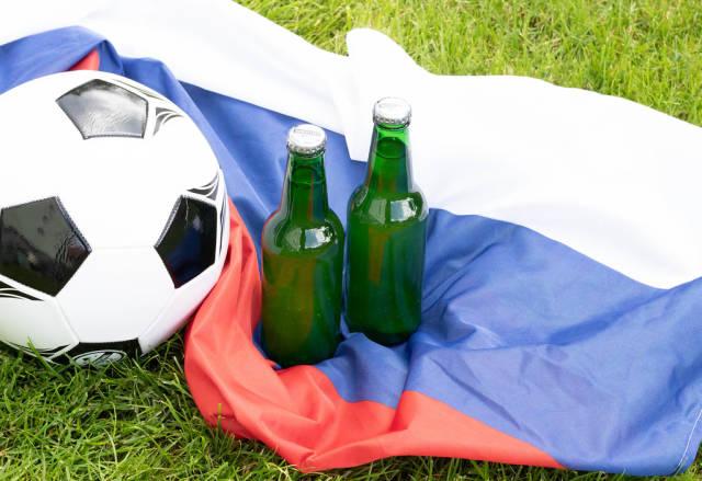 Beer bottles on Russian flag