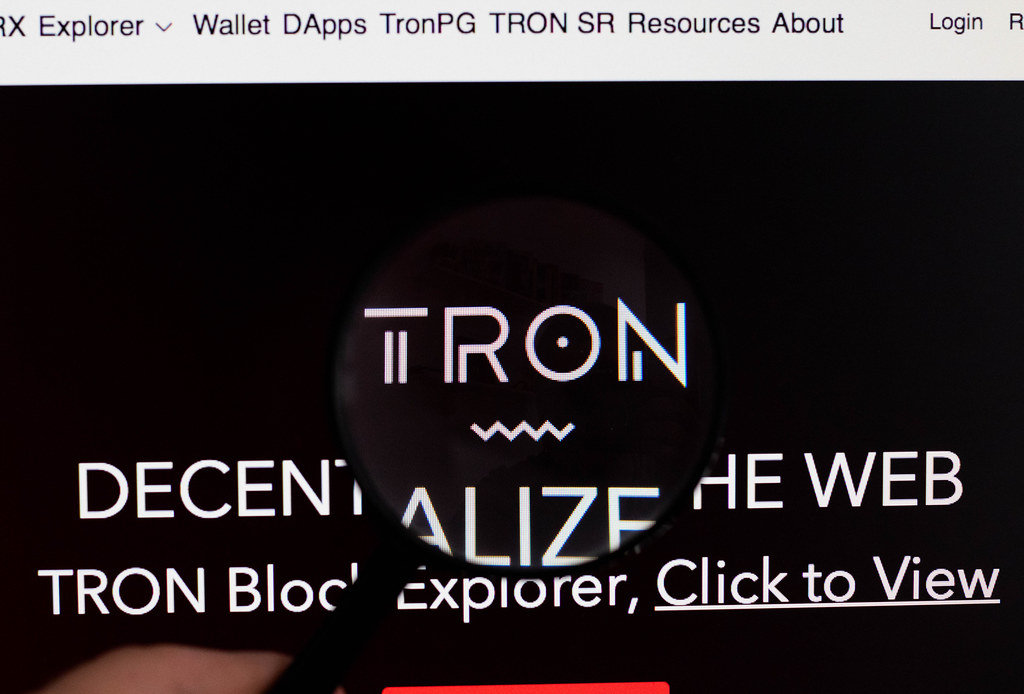 Tron logo on a computer screen with a magnifying glass
