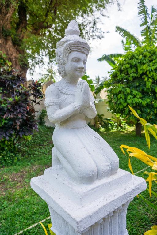 Kneeling Buddha Statue in Phnom Penh