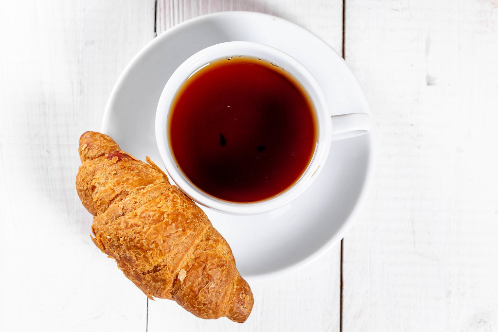 Fresh croissant with a Cup of tea