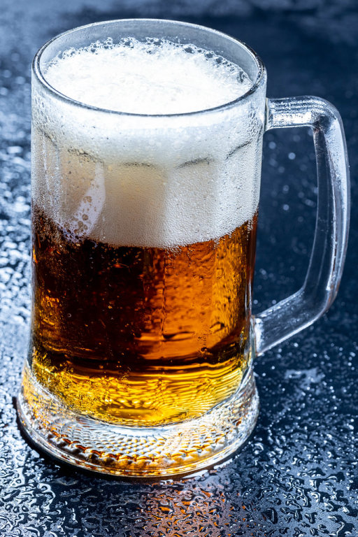 Glass of fresh beer with foam