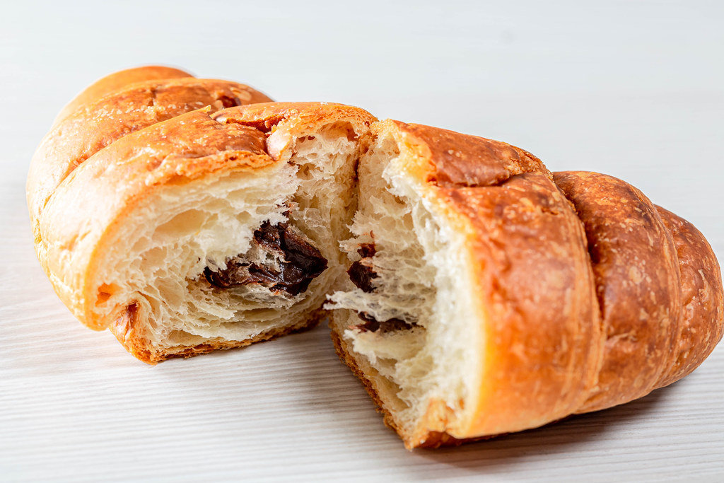 Croissant with chocolate filling on white background