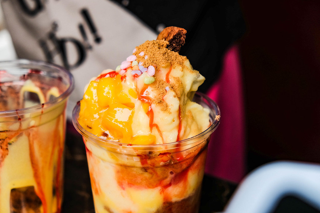 Close up shot of a mango smoothie with toppings