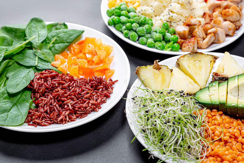Close up of three plates of healthy food