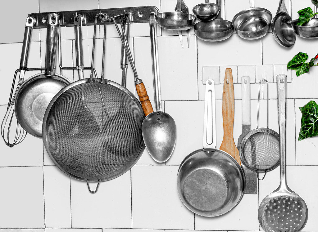 Old kitchen utensils hanging on the wall