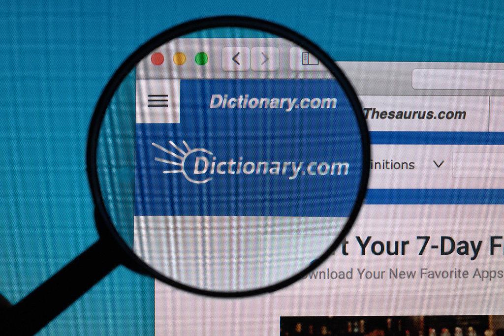 Dictionary.com logo under magnifying glass