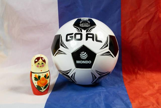 Matryoshka doll with soccer ball on Russian flag