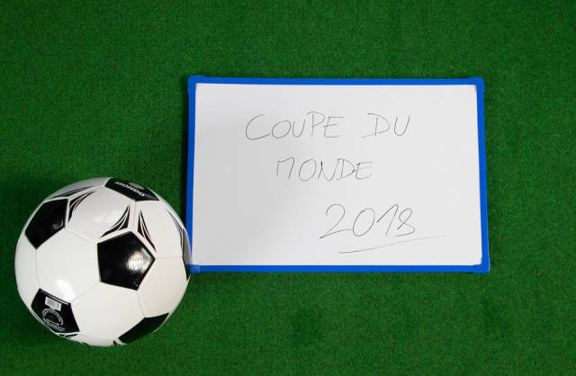Soccer ball with Coupe du monde written on board