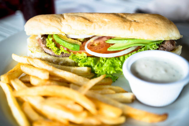 Sandwich with french fries and dressing