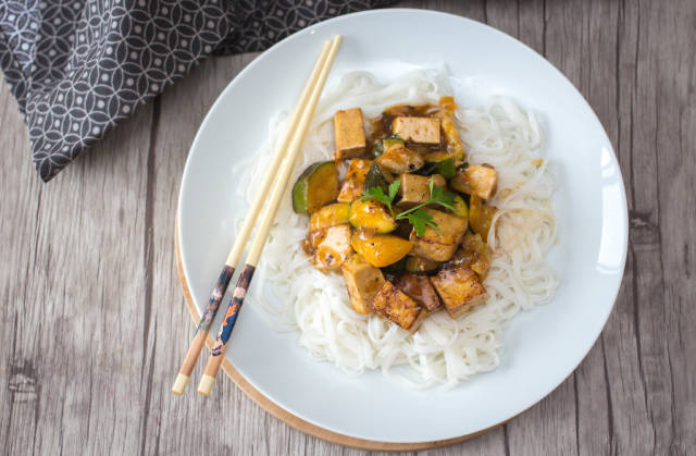 Tofu in a sauce on rice noodel top view