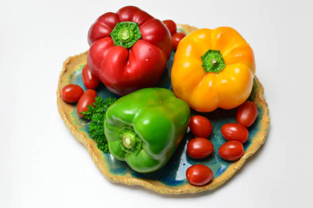 Yellow peppers, red peppers, green peppers and cherry tomatoes