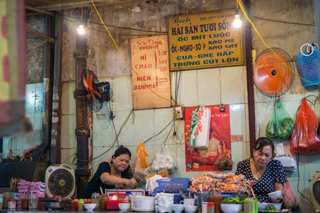 Vietnamese Food Vendor at Dong Xuan Market in Hanoi