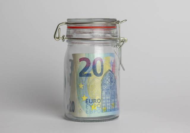Money jar containing 20 Euros