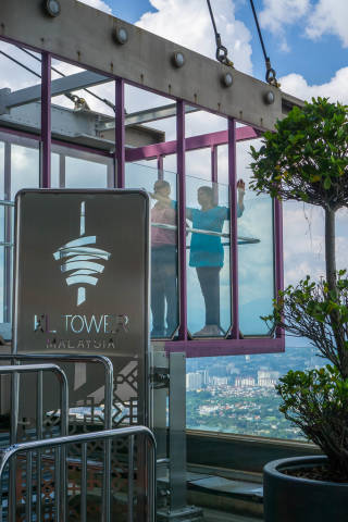 People standing in the Sky Box of KL Tower in Kuala Lumpur