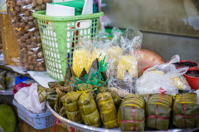 Traditional Rice Cake with Filling Banh Tet at a Market in Saigon