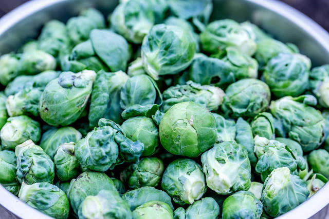 Brussels sprouts in an iron bowl