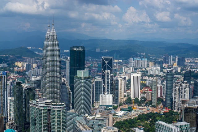 View of Jalan Ampang District with Petronas Twin Towers from KL Tower in Kuala Lumpur