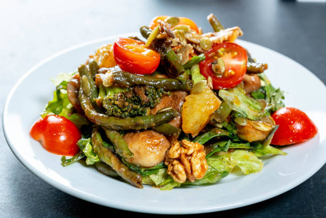 Fresh mix of vegetables, mushrooms and nuts in diet salad