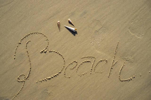Beach written in Sand with Sea Shells in Vietnam