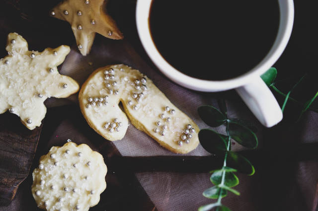Top view of christmas cookies and a cup of coffee