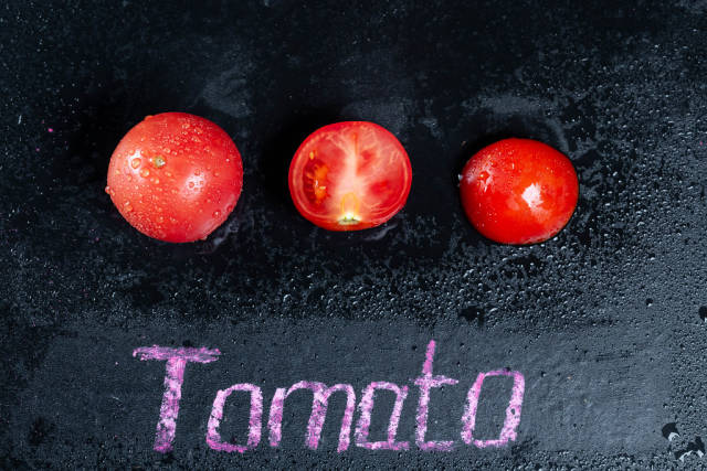 Ripe tomatoes with water drops with the words